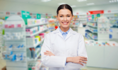 smiling female pharmacist at the pharmacy